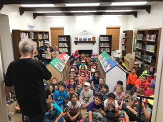 Students enjoy a presentation in the Children's Library